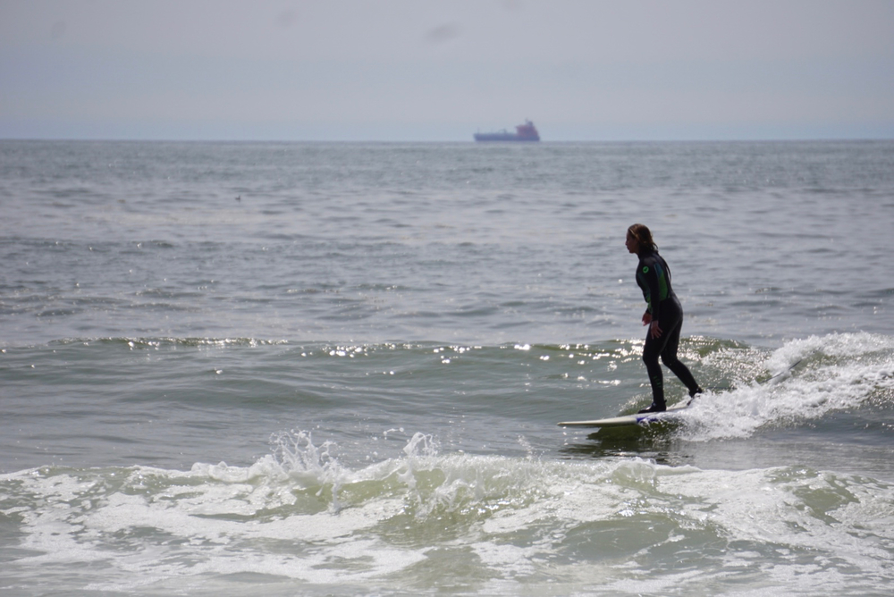 Beccy cruising on glassy Long Beach wall.