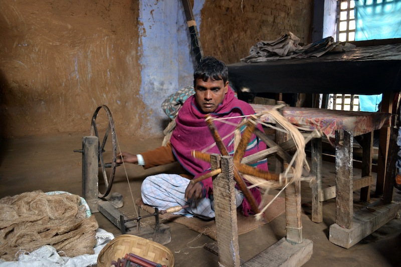 Sanjeev prepares silk thread for the loom. January 2013.