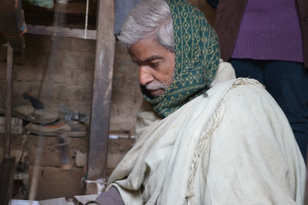 Bindu concentrates as he lays special threads to construct a traditional design in a silk scarf. January 2013.