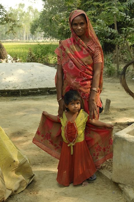 Samridhi employee Meera Devi with her daughter Anju. October 2011.
