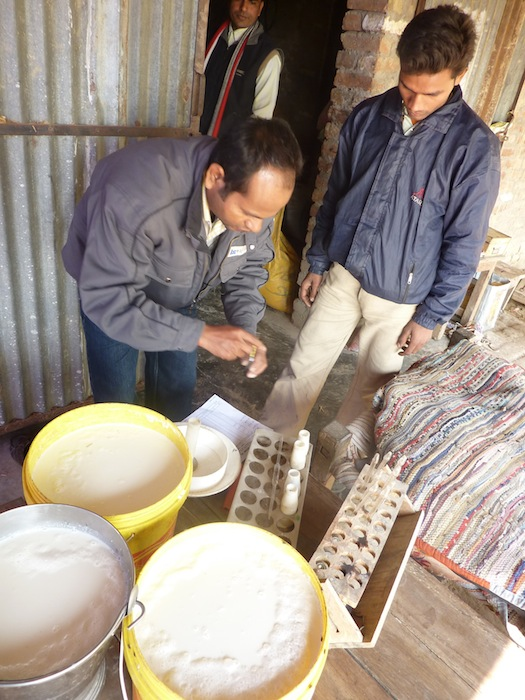 Samridhi Center Manager Sunil (left) conducts a second round of quality testing at a Samridhi facility as a trainee looks on. January 2012.