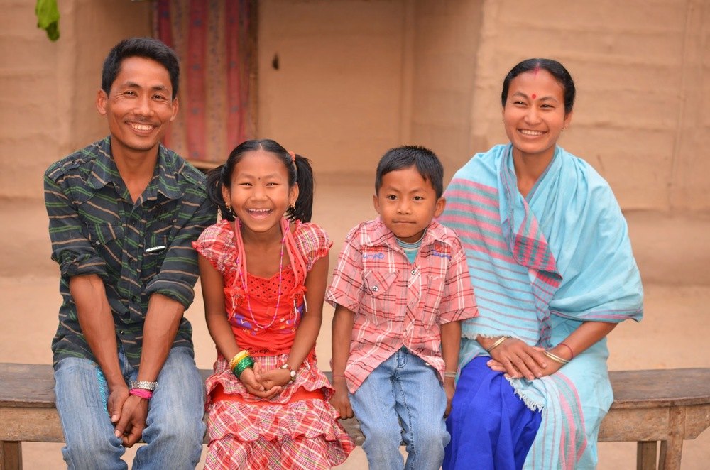 (left to right) Dimbeshwar, Dimpole, Dipangkar, and Kolpana pose in front of their house