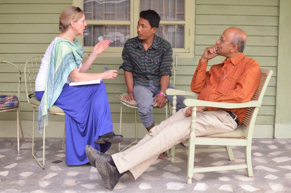 Dimbeshwar (center) speaks with Upaya Advisor Suzanne Skees and Elrhino Founder Mahesh Bora on the porch of the company office.