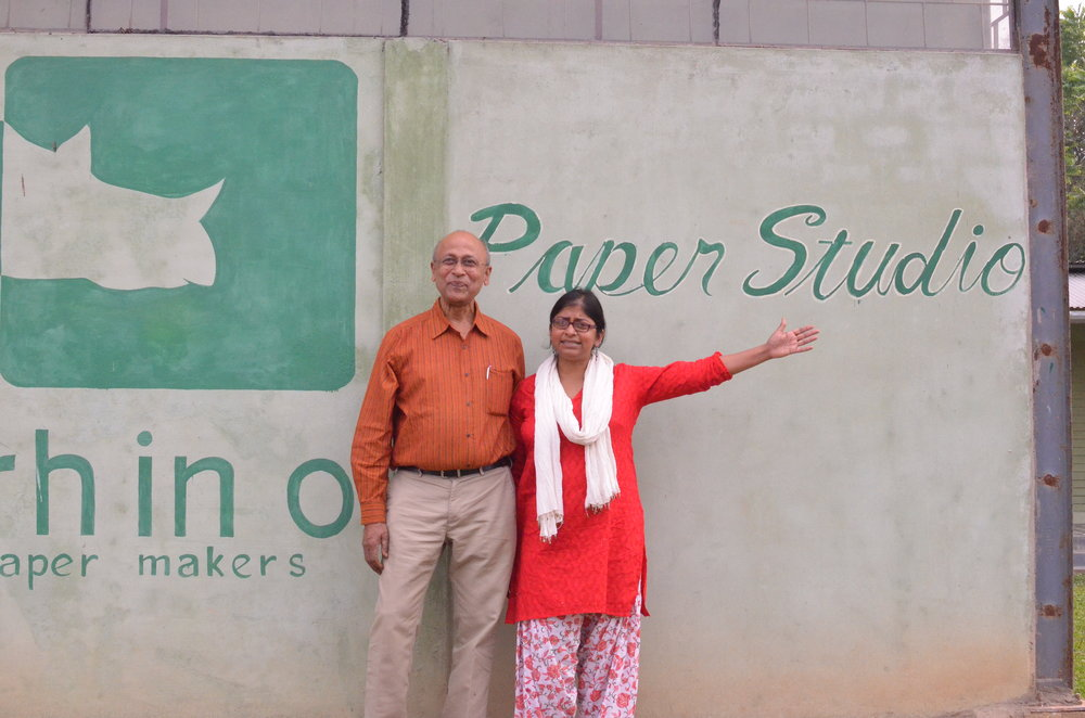 Nisha poses with her father and Elrhino co-founder in front of their factory in Guwahati.