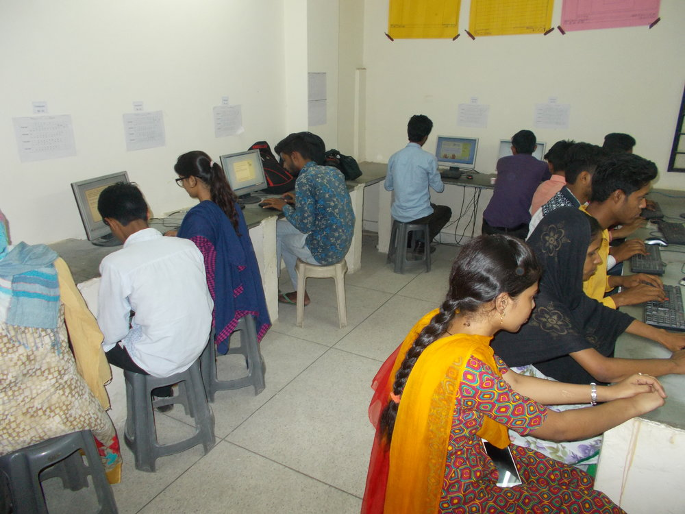 Students learning computer skills through UpSkill's technology-based vocational training platform.