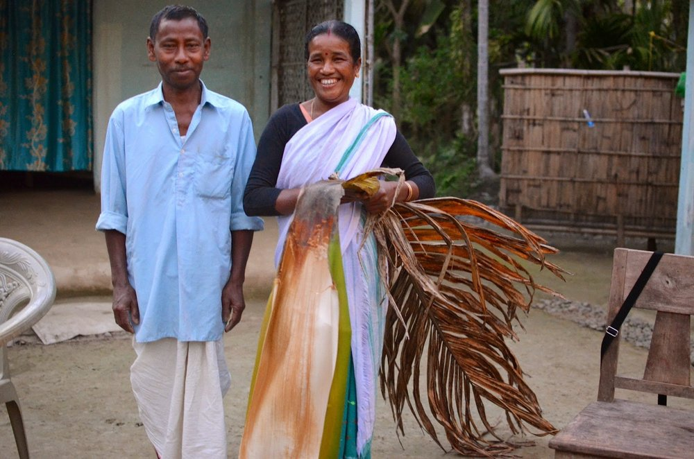 Bhupen Das and his wife collect raw materials for Tamul Plates, a job that is helping their family out of extreme poverty.