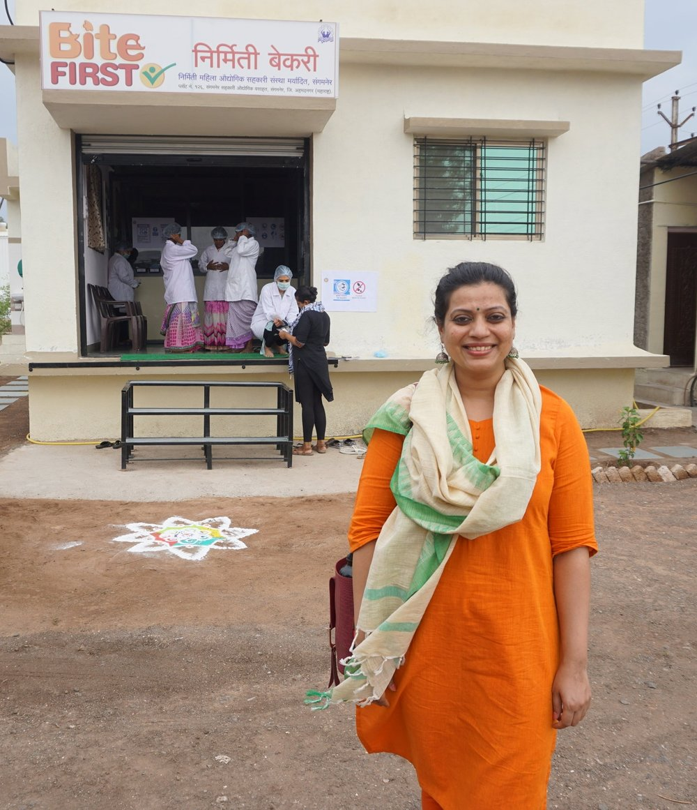 Reema Sathe of Happy Roots in front of one of her cookie processing facilities.