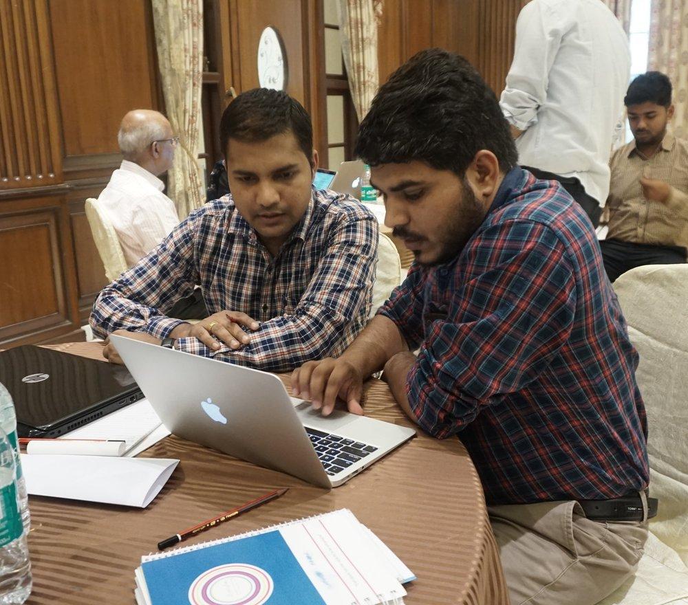 Amit Choudhary , Upaya's Finance Management Associate works with Jitendra Yadav, founder of  Aikya Organics  on the company's financial model during the 2018 Upaya Accelerator.