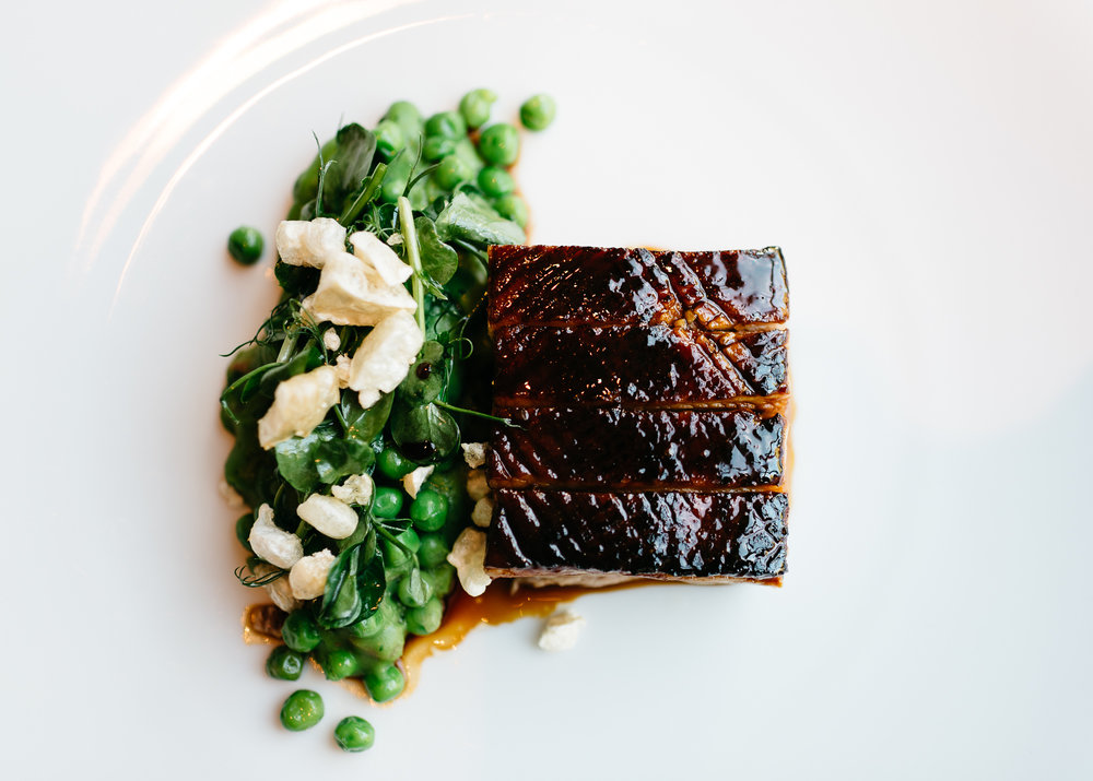Slow cooked pork belly at Dinner by Heston Blumenthal with spelt, lardo, baby turnip & Robert sauce