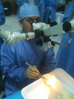 Bolivian neurosurgeon Dr. Carlos Dabdoub perfects drilling techniques using a microscope.