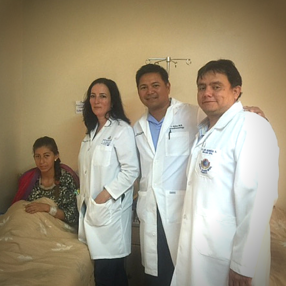 Recovering patient, Teresa, Dr. Gay Garrett, Dr. Andy Guiao, and Dr. Lucho.