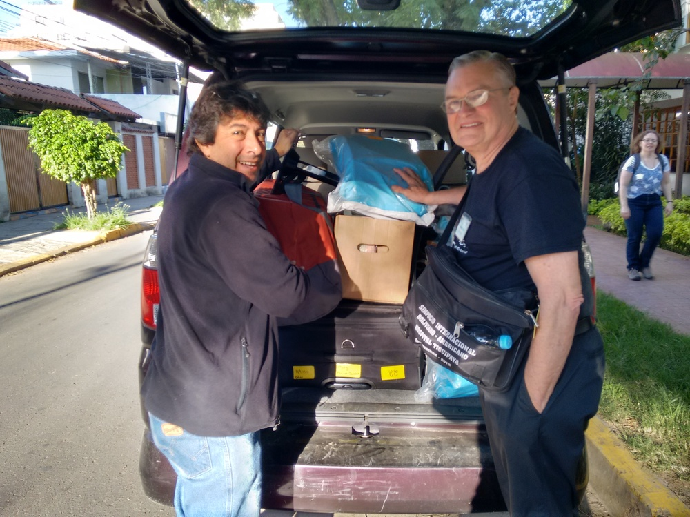 Puente de Solidaridad support staff, Alfonso Flores, assisting SB missioner, Dr. Ron Miller, in packing a van with medical supplies.