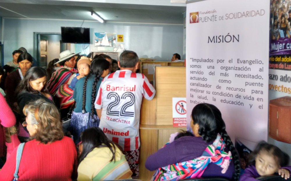 Families in the waiting room at Tiquipaya Hospital are greeted by the mission of Puente de Solidaridad posted in the room.