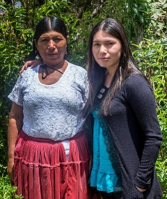 Elena (right) with her mother in 2016