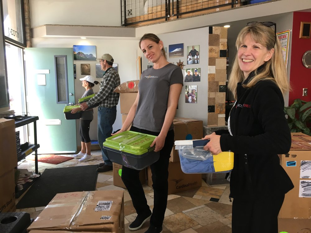 From left: Lindsay Doucette, senior director of programs and Cynthia Judge, Solidarity Bridge board secretary with supplies