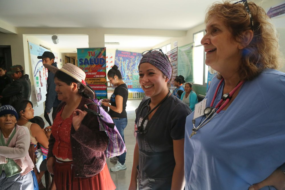 Greeting patients in the reception area with fellow mission nurse, Jackie Mortillaro.