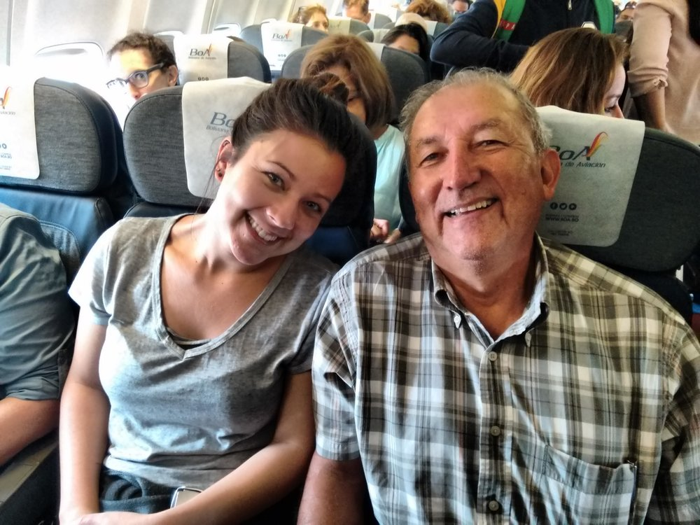 Kristina, with her grandfather and Solidarity Bridge co-found, Enrique Via-Reque, on a flight from Santa Cruz to Cochabamba