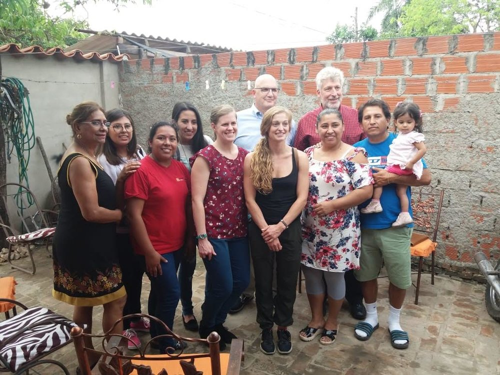 Our mission team at the home of a previous patient, little Sara Lucia