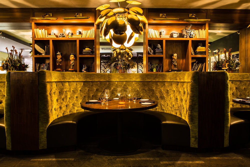 Sinema's two bars each have their own distinct personality. Downstairs is glitz and glam with a full view of the sweeping lobby that once held crowds waiting for the screening of the latest Hollywood blockbuster in the former movie theater. Read more on Thrillist.