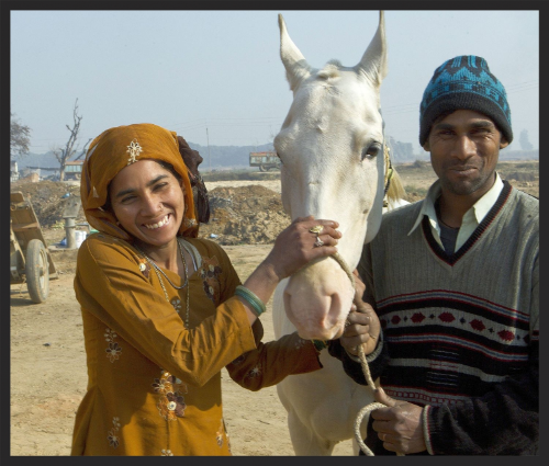 This is 26-year-old Kallu with his wife and their 4-year-old horse Baadshah. They all work together in a brick kiln in Uttar Pradesh, India. Kallu is a member of the 'Peer Baba' equine welfare group at the kiln, which is facilitated by the Brooke.