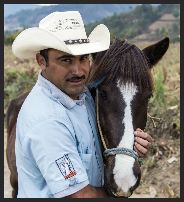 Brooke veterinarian Dr Marco in Guatemala with a patient. Photo by Richard Dunwoody