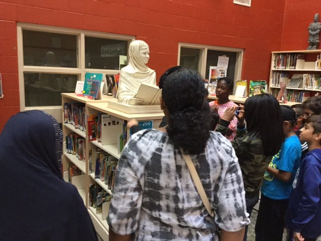 Students interacting with Malala sculpture at Lougheed Middle School