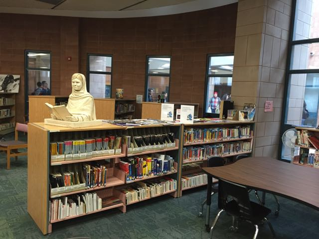 Malala sculpture at home in the John Fraser Secondary School library