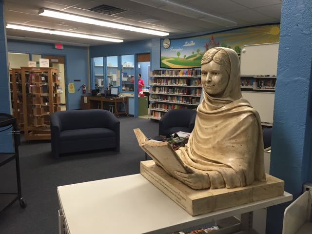 Malala sculpture at home in the Greenbriar Middle School library
