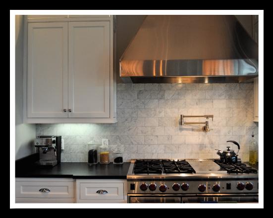 Black Absolute Granite Countertops w/ Cararra Marble Backsplash