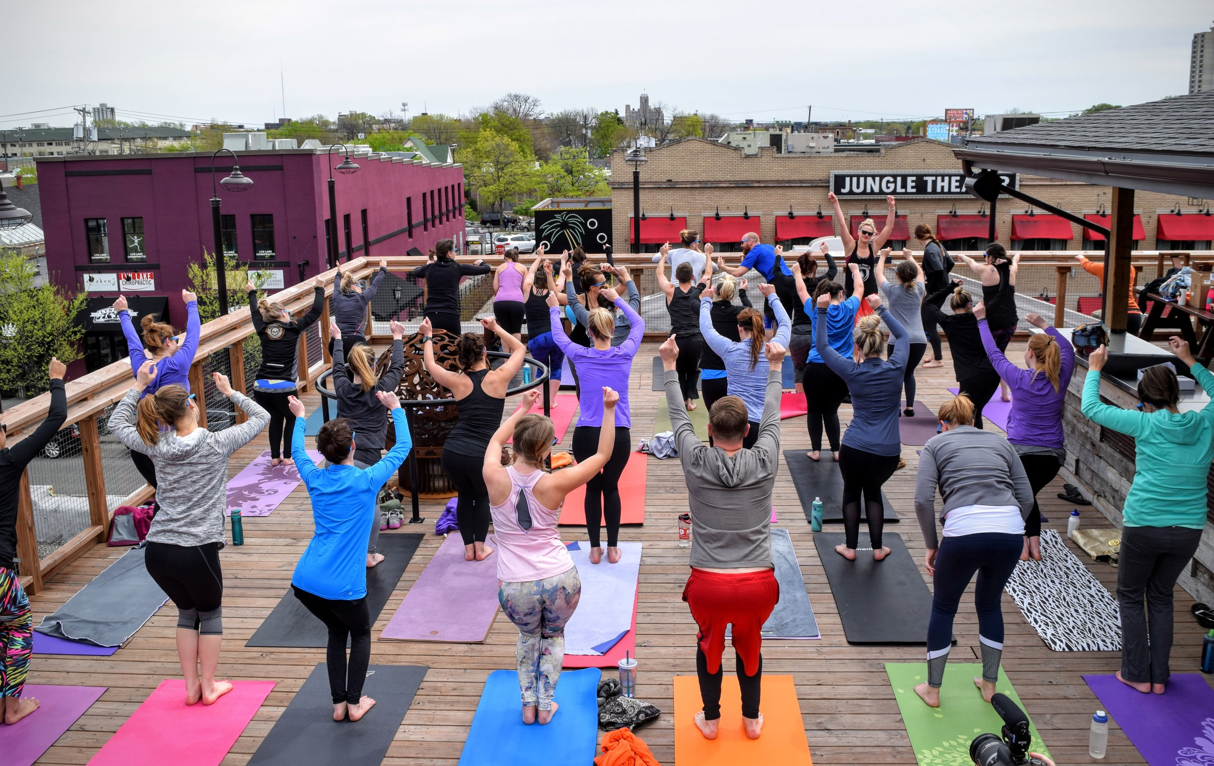 Rooftop Yoga with Om Brewers — LynLake Brewery