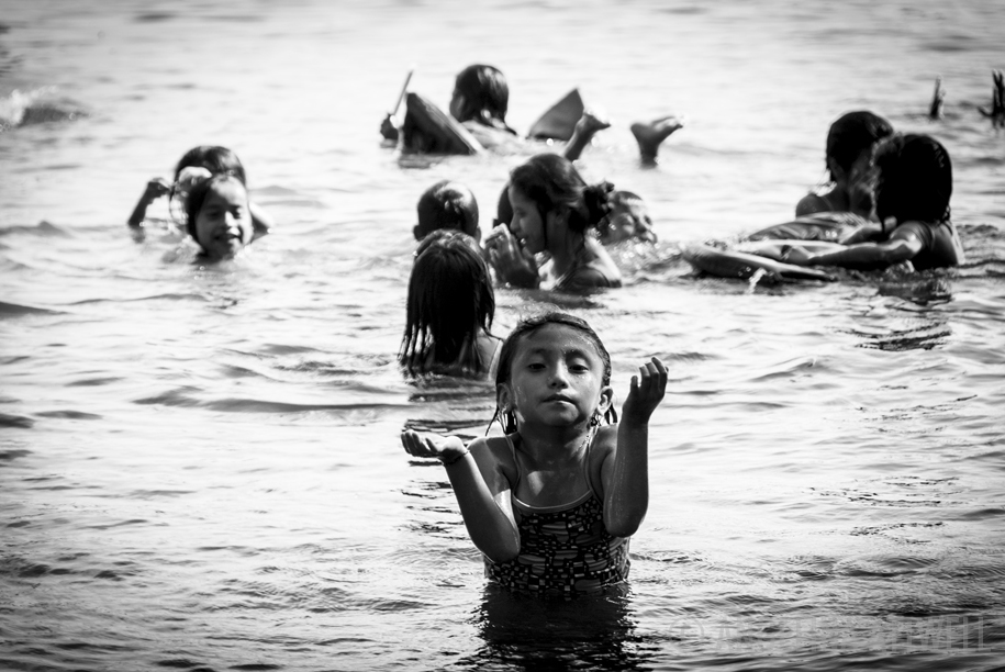 GIRL in the water  (Rio DUlce, Guatemala)  11 X 17 PRINT$55  20 X 30 PRINT $105  A moment of serenityamdist playtime. For the kids of Casa Guatemalaeach summer day ends with swimming and jumping in the river. The rio Dulceprovides anescape from the heat, humidity and mosquitos ofthe jungle'ssummer swelter. © Angelina Attwell