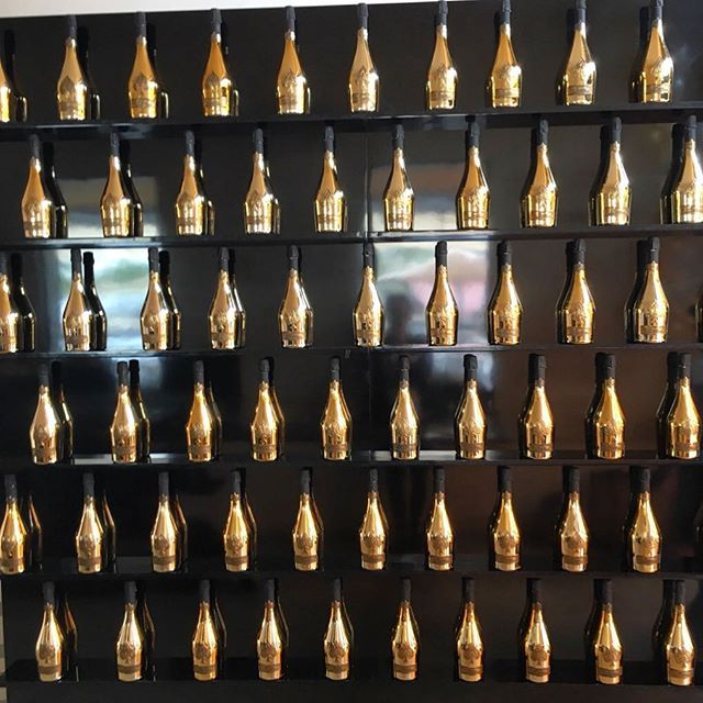 The Bottle Wall! 🍾 Custom built black mirrored 8 ft wall with floating shelves for @armanddebrignac bottle display - holds 66+ bottles #aceofspades #champagne ♠️⚜️