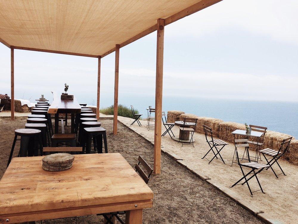 Tables + the view at Cuatro Cuatros