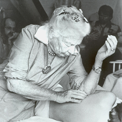 Dr. Ida Rolf working with a client
