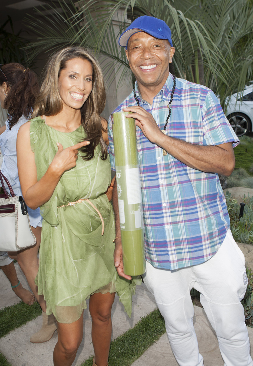 Rainbeau Mars and Russell Simmons model a Yoga Mat courtesy of sponsor Manduka