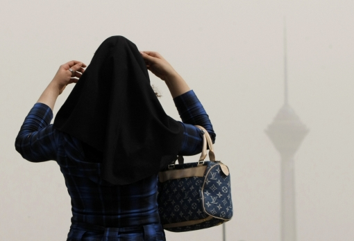 An Iranian woman adjusts her headscarf in central Tehran. Photo: Getty