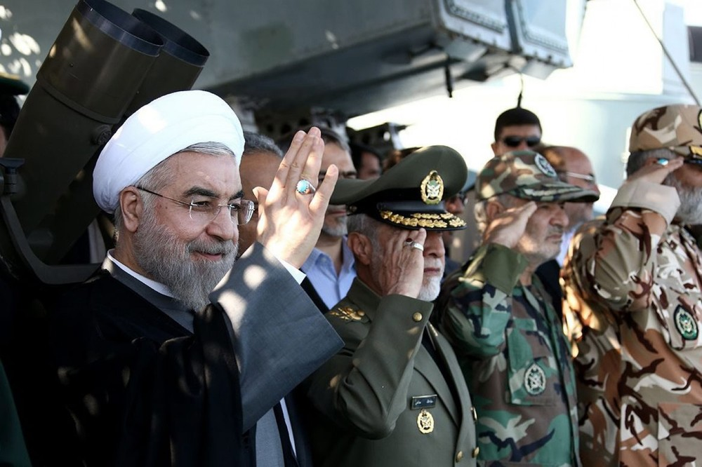Iranian President Hassan Rouhani, left, at a navy parade in December in the city of Bandar Jask. In her book, Nazila Fathi describes Iran's fluid politics. (Official Presidential Official Web site via european pressphoto agency)