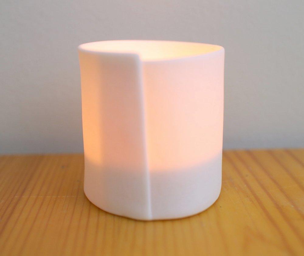 Simple, warm tea light holder