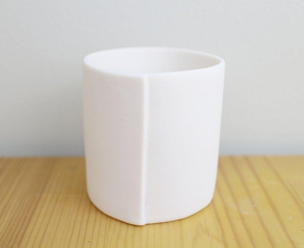 Translucent porcelain tea light holder cold.JPG
