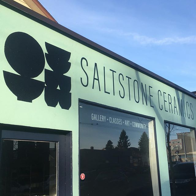 "I just took a quick trip to Seattle, dropping off a few boxes of new work to Sarah and her crew at @saltstoneceramics in Wallingford. What a great spot! It's busy, well-used, well cared for, and they only opened a few months ago. They have classes, workshops, and a gallery space to showcase rotating artists (like me!) and the gorgeous work of the Saltstone team. I don't miss living in the city, but having access to spots like this is pretty special. . I'm participating in a show called ""Hygge,"" that Scandinavian word/culture that means something like coziness, warmth, togetherness, and slowing down. Most of what I brought glows, including a whole neighborhood of tiny porcelain houses, and the two lamps from my stories this morning. So cozy."