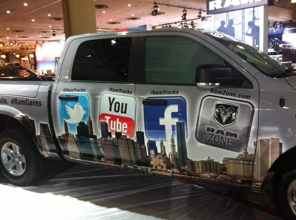 Social Media Dodge Ram.  We tinted this truck with special touch screen and projection film. It was displayed at the New York International Auto Show. Attendees could actually sign in and leave status updates on Facebook and Twitter right from the show floor!  Check out the video to see us tinting the windows.