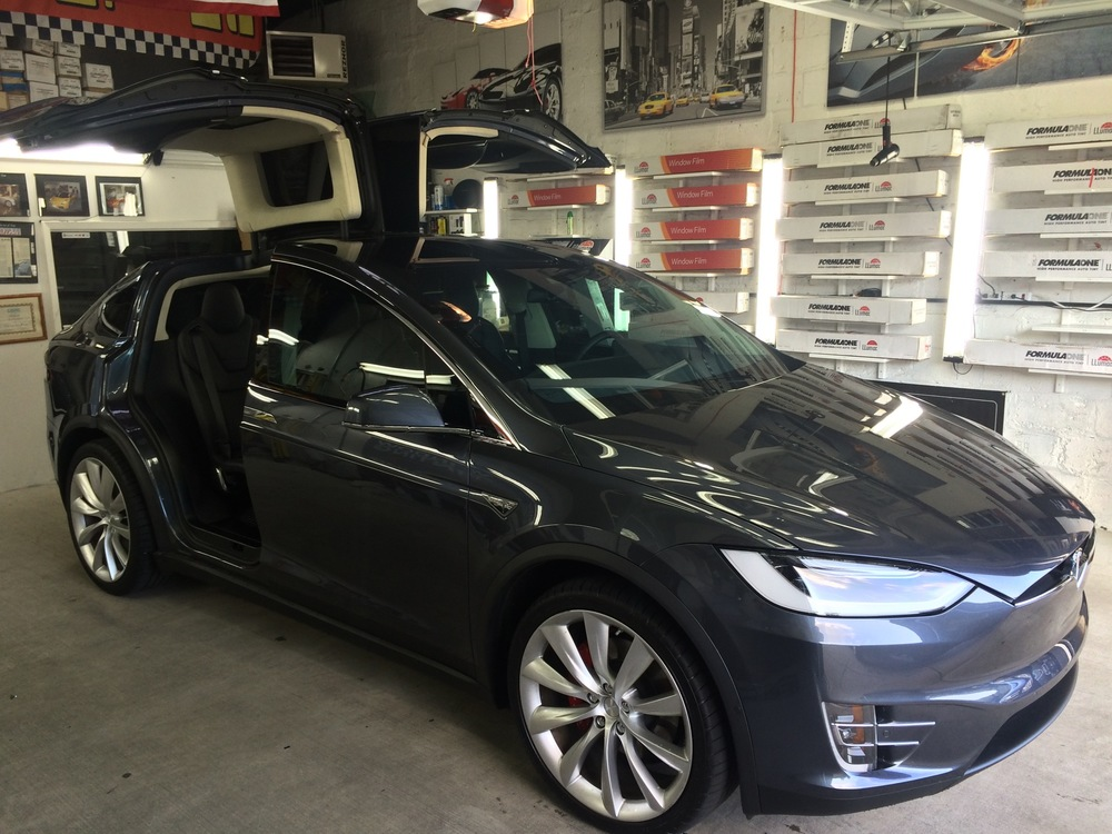 New York's ONLY certified window film installer recommended by TESLA