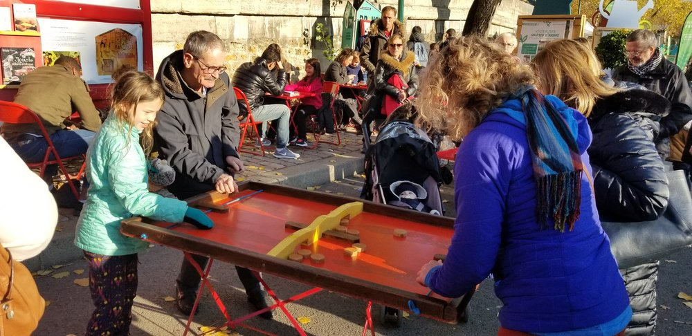 And games on the street too. We loved this one! There were ping-pong tables, folks playing with Jenga blocks. All sorts of fun. But boy oh boy it was cold - Sophie was wearing mittts. Glad I was wearing my furry coat!