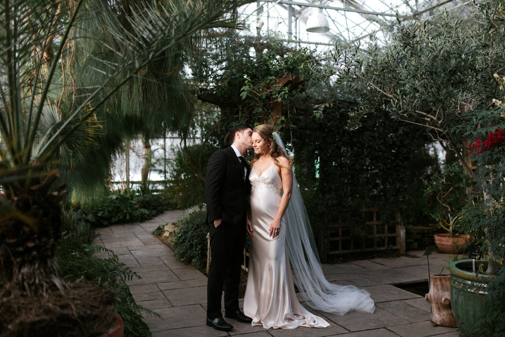 Romantic couple kissing in greenhouse