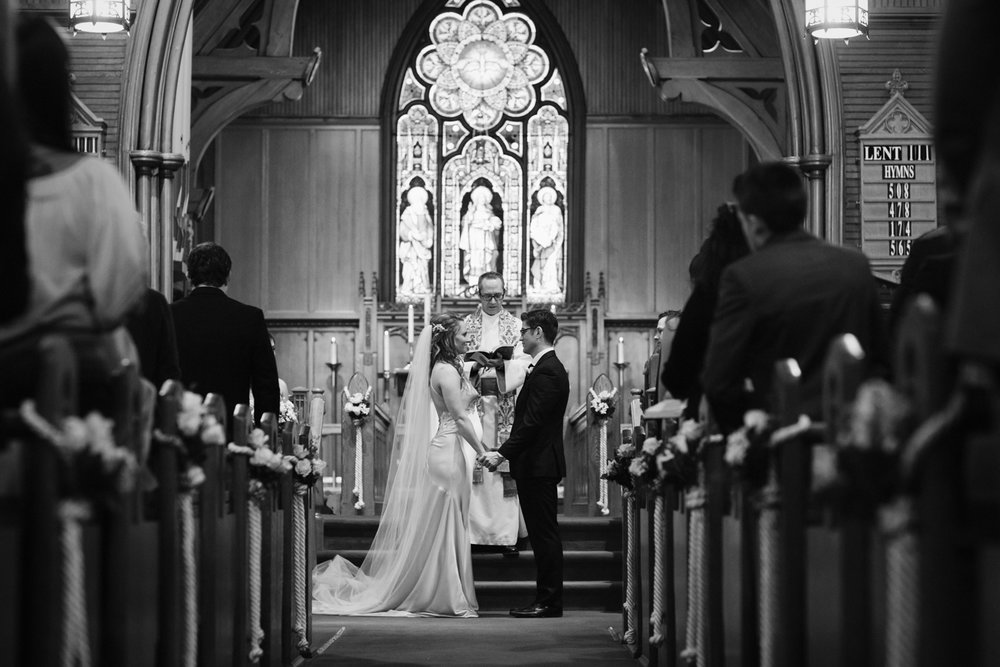 Couple standing at altar