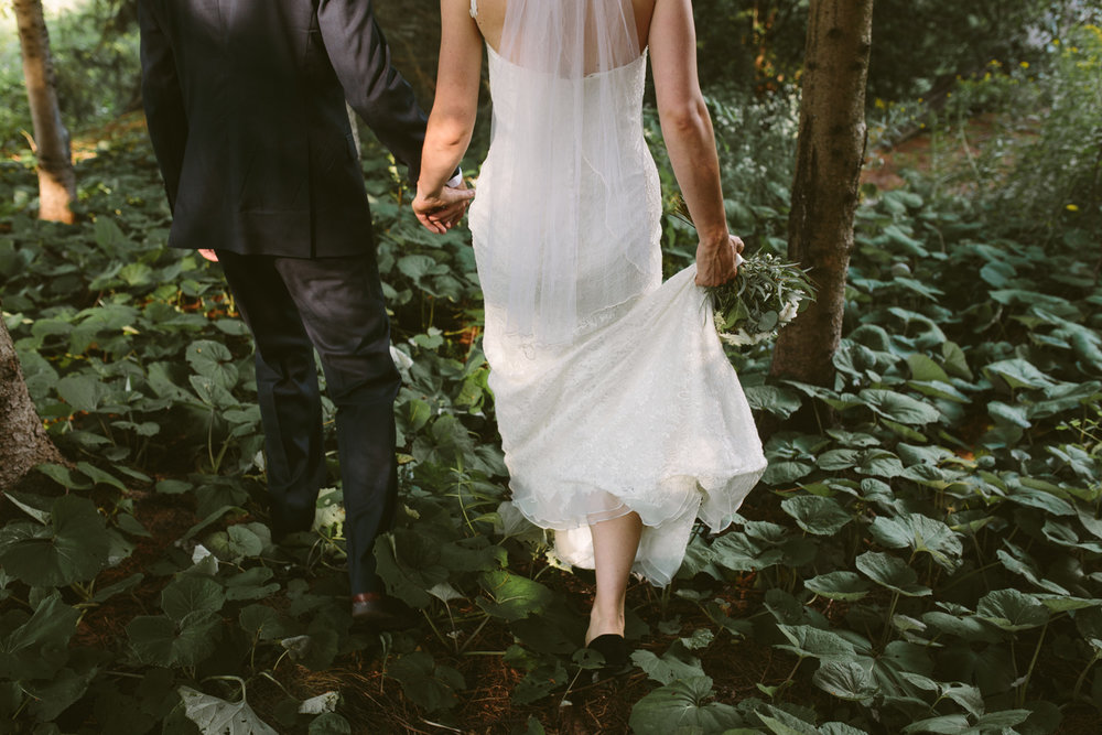 Couple walking through a lush forest