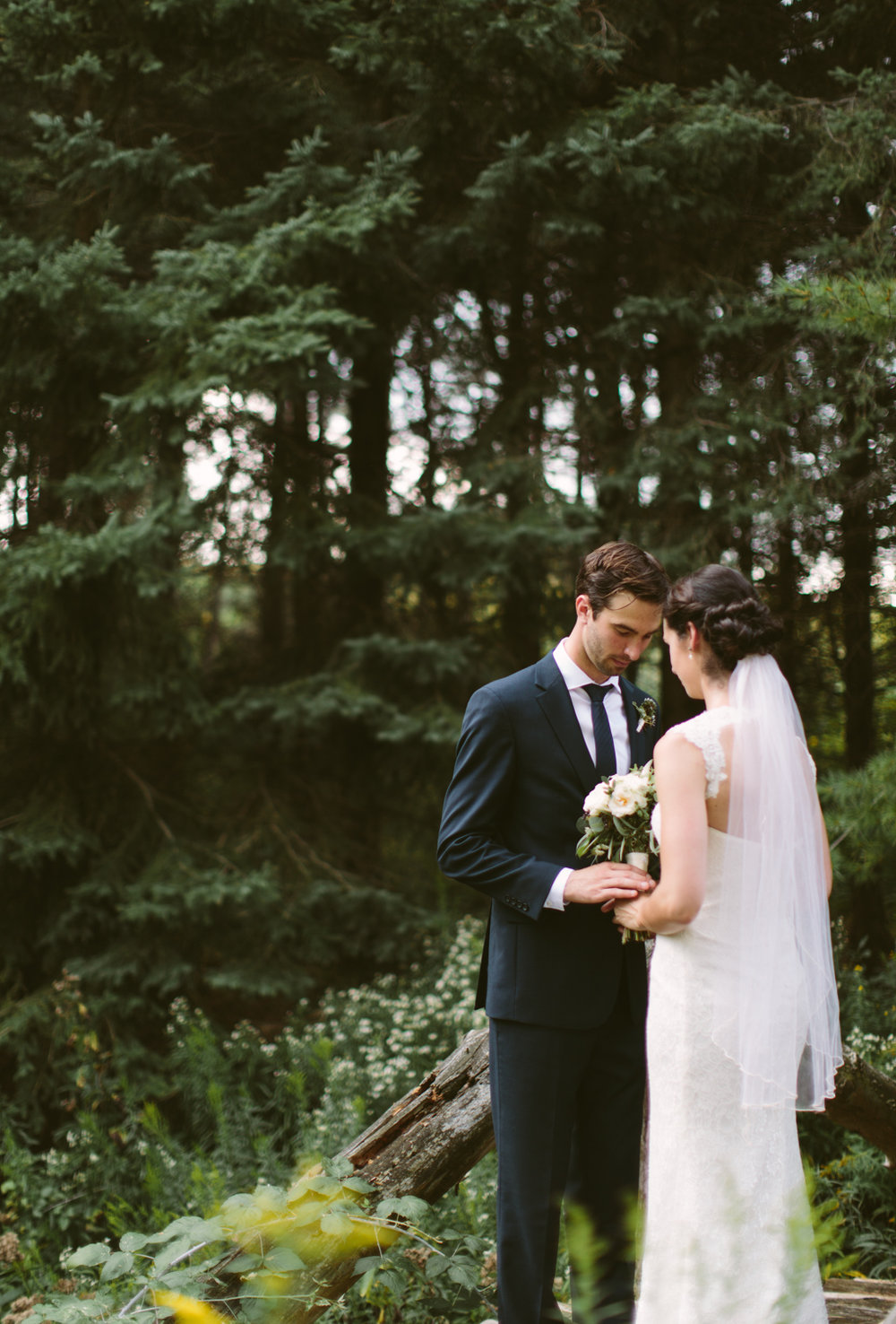Couple sharing their vows in a forest