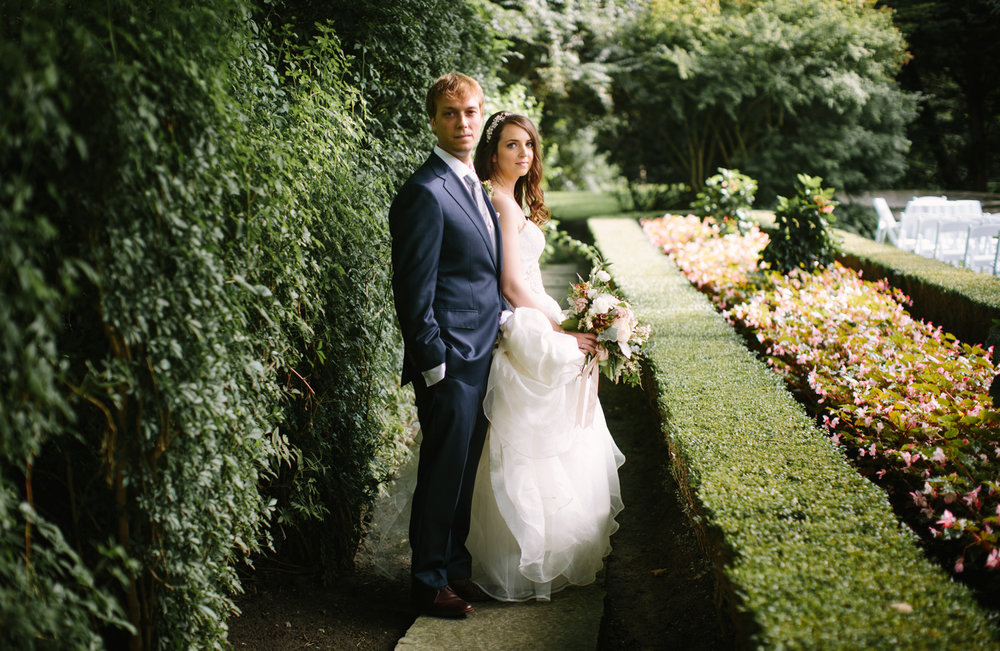 Bride and groom in a garden