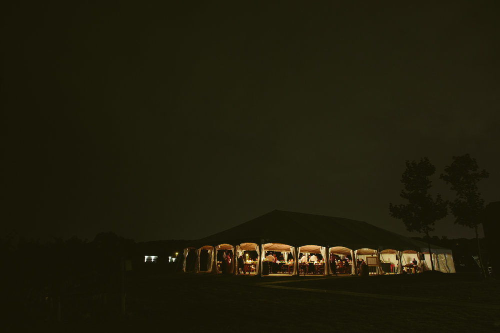Night shot of tented ceremony