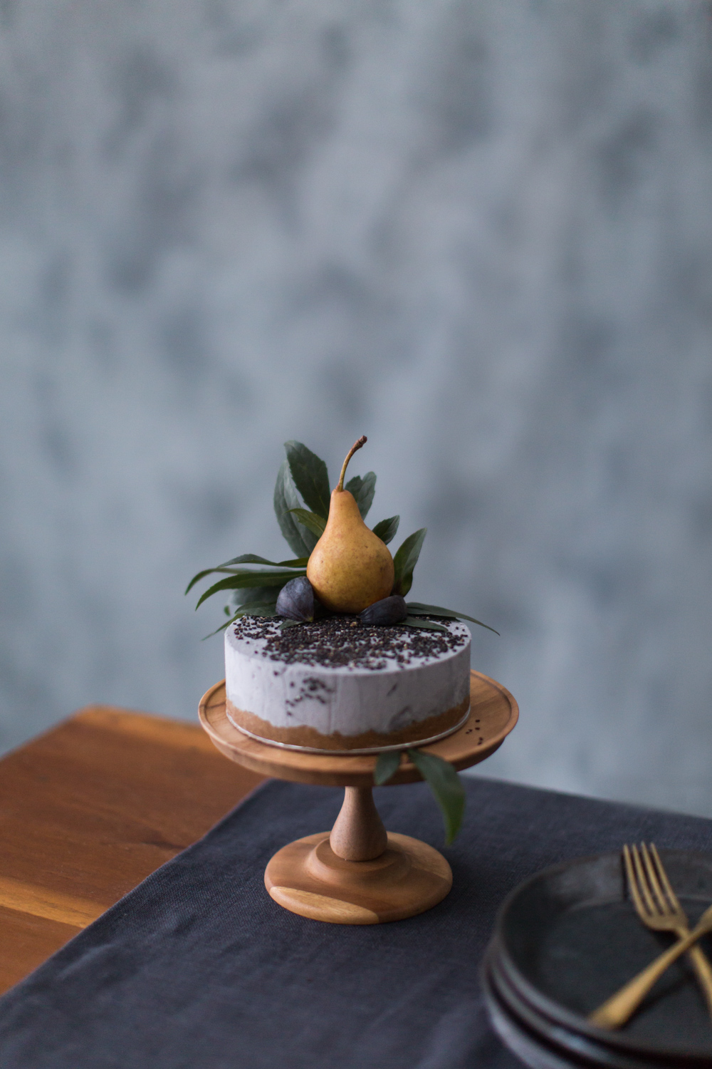 Black sesame cake and brass cutlery